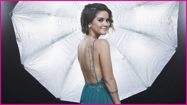 Maren Morris, who won New Female Vocalist Of The Year presented by T-Mobile, looks marvelous in this back-revealing number.