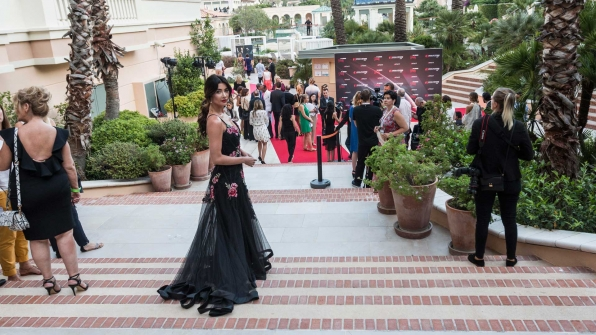 In a gorgeous black gown with floral appliques, Jacqueline MacInnes Wood makes her way into the Monte Carlo TV Festival's Pool Party.