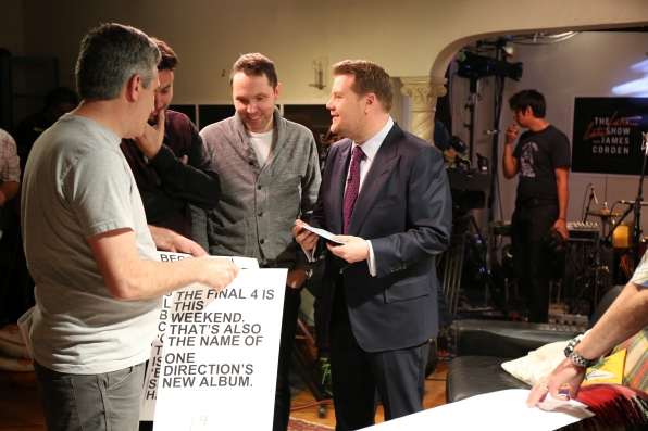 Corden confers with his brain trust.
