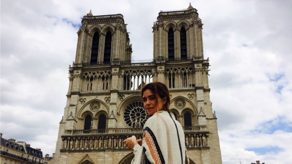 Amelia Heinle (Victoria Newman) struck a pose outside the Notre Dame in Paris.