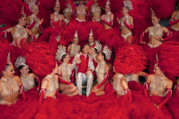 Craig Poses for a Photo with the Dancers