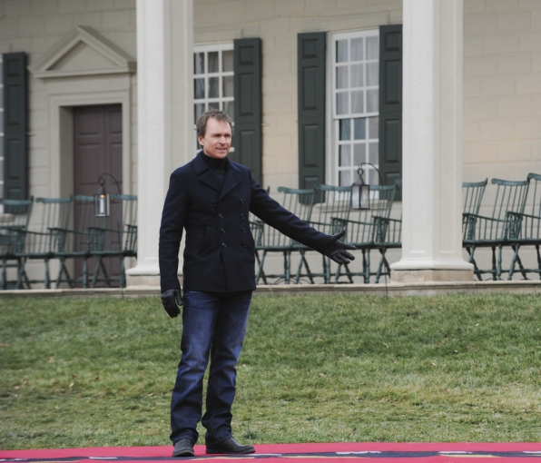 """Phil Keoghan waits on the mat in the season finale of The Amazing Race """"Beacon of Hope"""""""