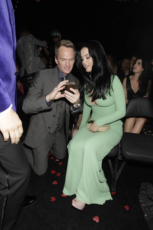 (2013) We're wondering what Katy and Neil Patrick Harris are tweeting about. Please let it be us. (Photo by: Corbis)