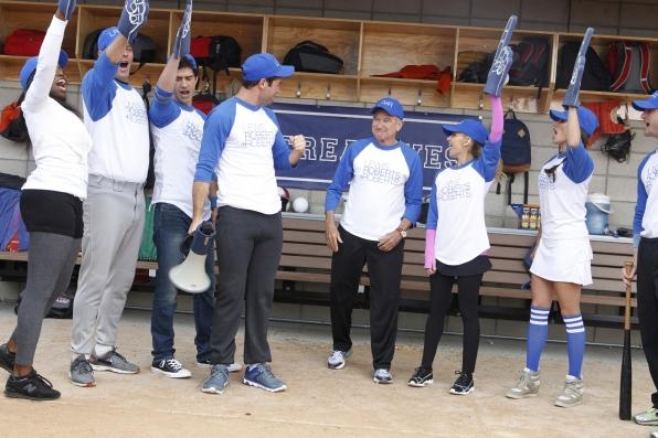 "High five in ""Sixteen-Inch Softball"" Episode 9 of Season 1"