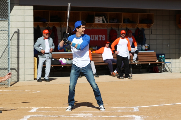 "Batter up in ""Sixteen-Inch Softball"" Episode 9 of Season 1"