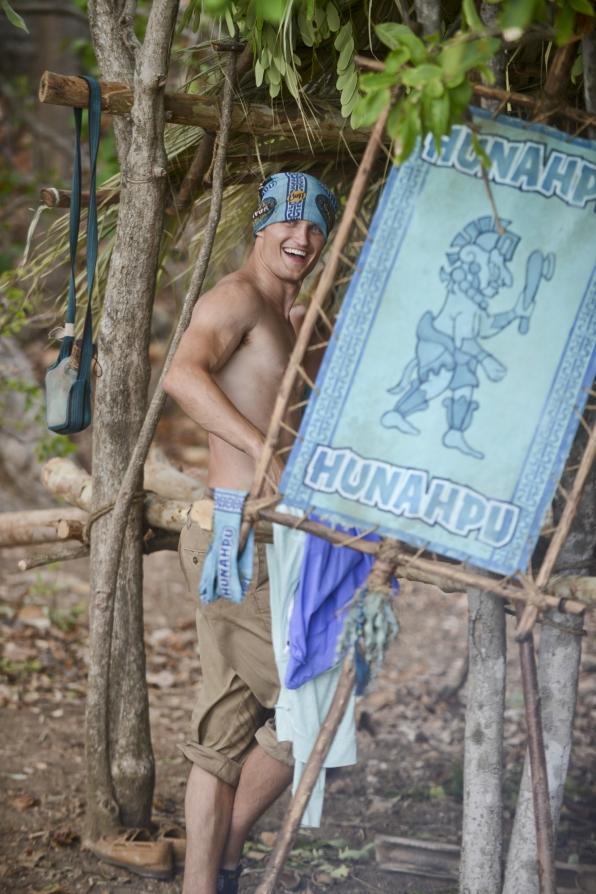 Jon near his tribe flag