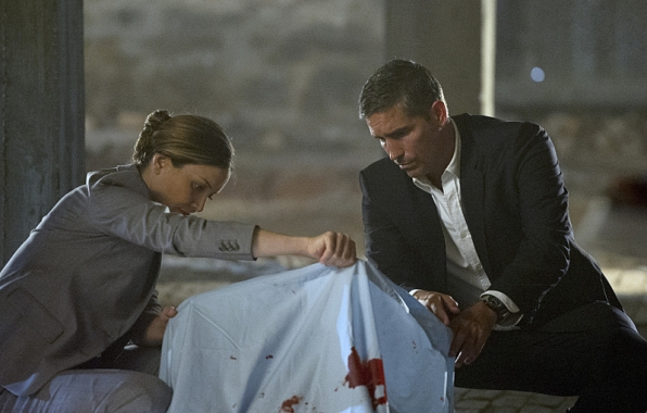 "Reese investigates a crime scene in ""Brotherhood"" S4E4"