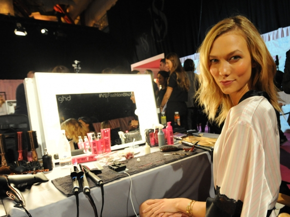 Karlie Kloss gets ready for the show.