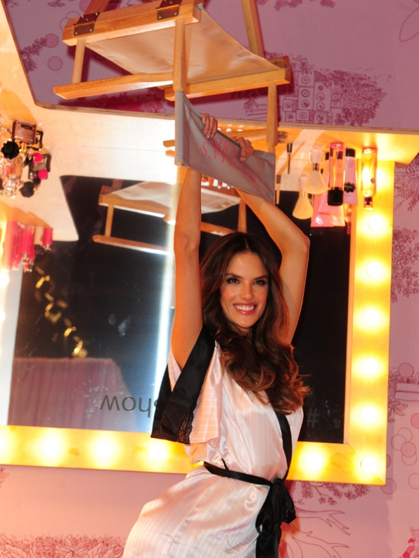 Alessandra Ambrosio shows off her strength.