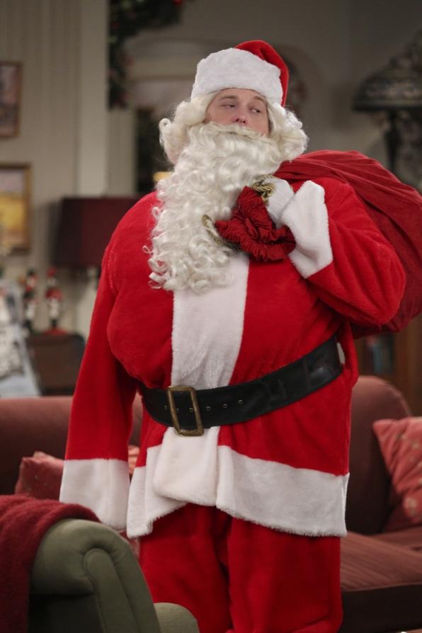 Mike dresses as Santa