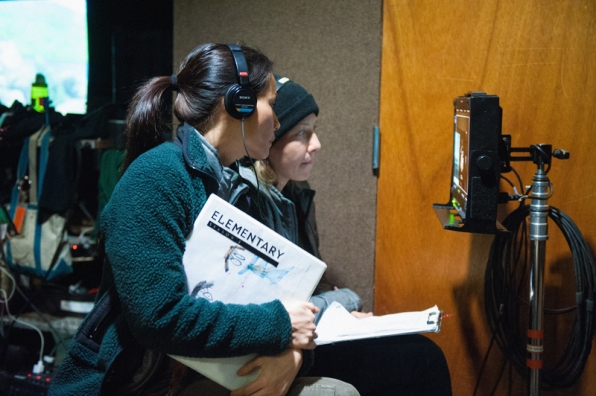 Lucy Liu and Script Supervisor, Olenka Denysenko, observe a scene being filmed from Video Village.