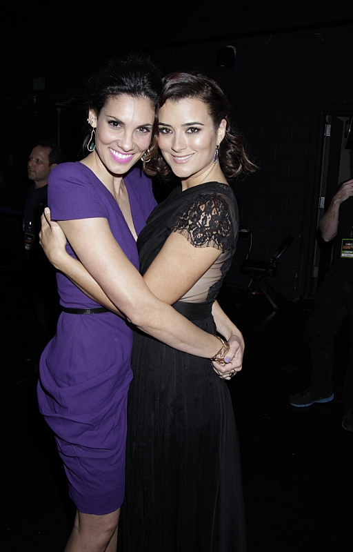 15. Daniela Ruah and Cote de Pablo share an embrace.