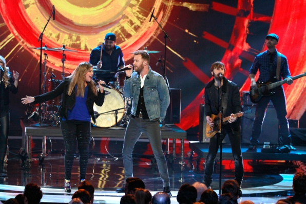 Lady Antebellum lights up the stage during their musical performance.