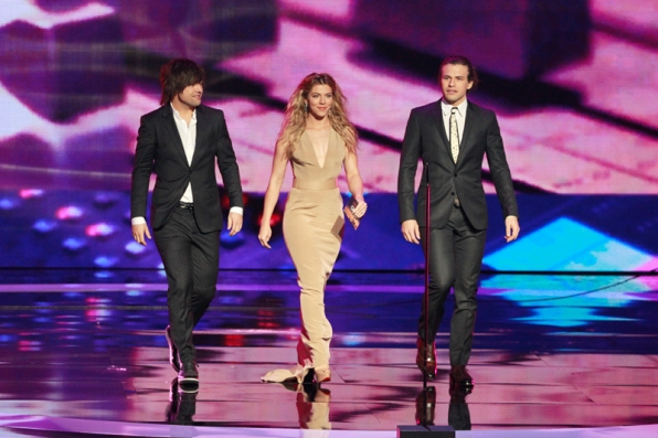 The Band Perry walks in style to present.