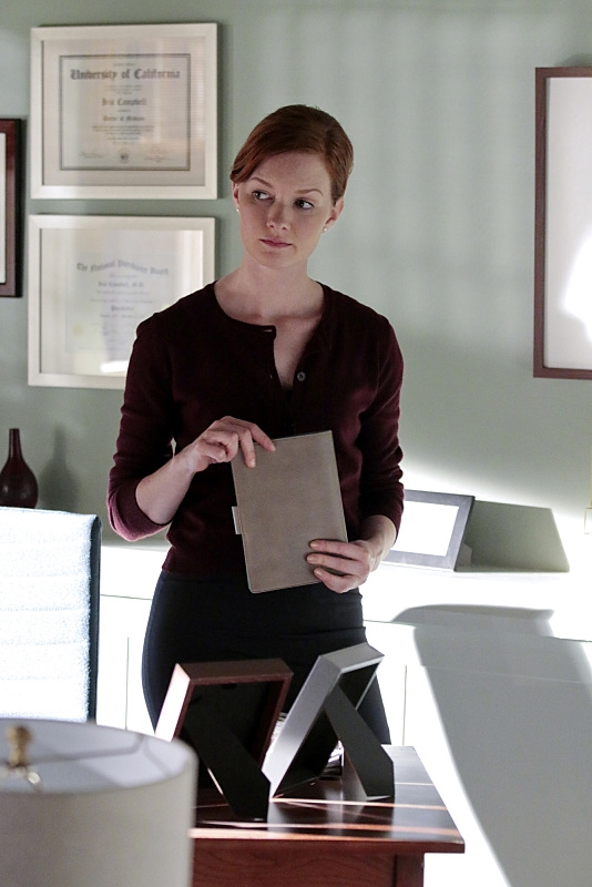 Wrenn Schmidt as Iris