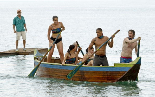 Jeff Probst watches as the Brains Tribe must learn how to paddle together.