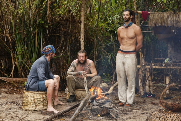 Neal, Jason, and Nick keep warm by their tribe's fire.