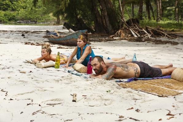 Julia, Aubry, and Scot sunbathe on the beach.