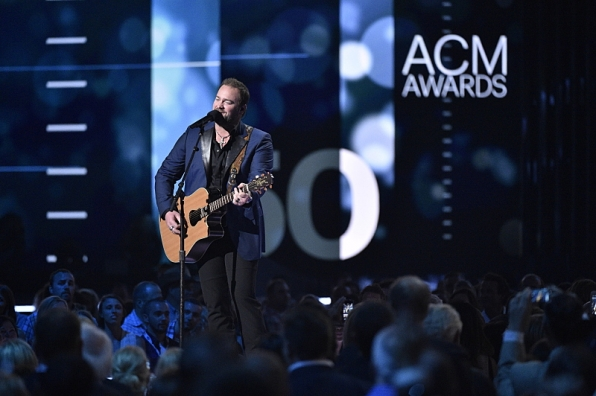 Lee Brice performs at the 50th ACM Awards.