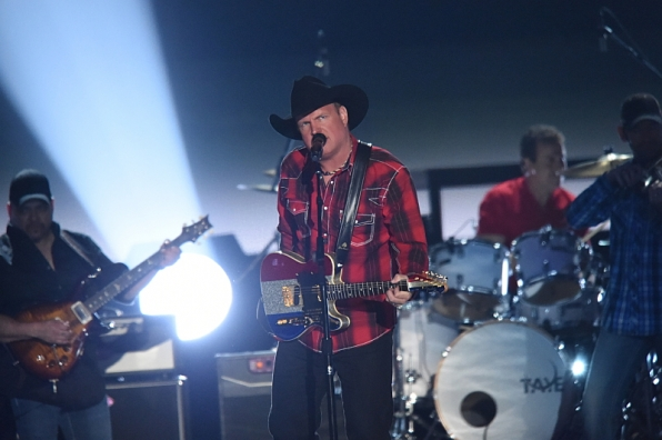 "Garth Brooks performed ""All-American Kid."""