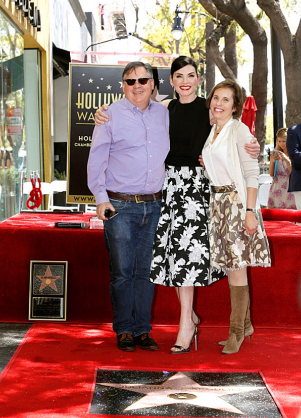 Series co-creators Robert and Michelle King posed with Julianna.