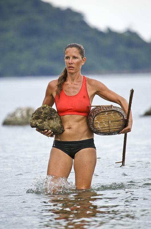 Kelly Wiglesworth goes clamming in the ocean.