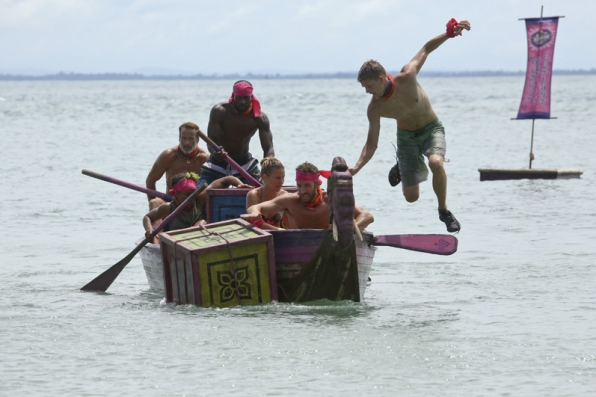 Spencer Bledsoe jumps out of the boat to retrieve a puzzle piece.
