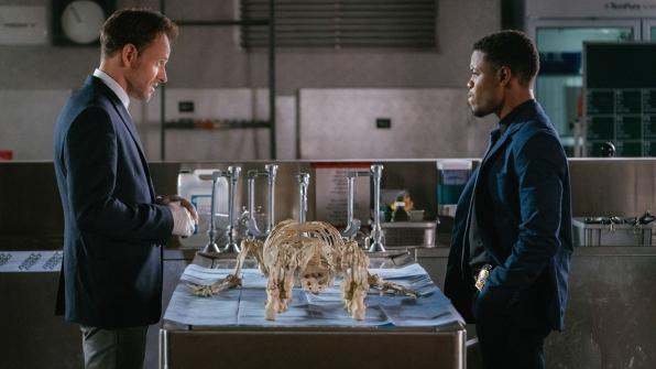Jonny Lee Miller as Sherlock Holmes and Jon Michael Hill as Detective Marcus Bell