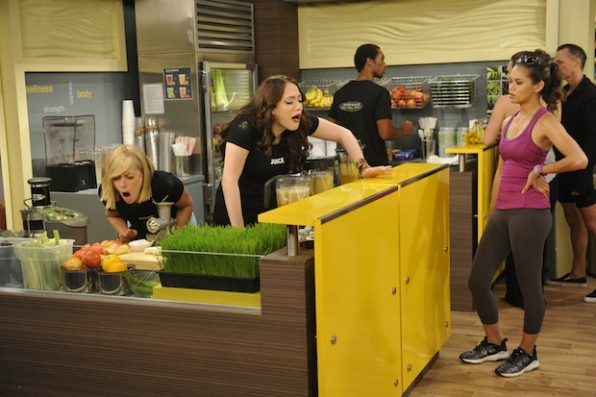 Max and Caroline are disgusted by something behind the juice bar