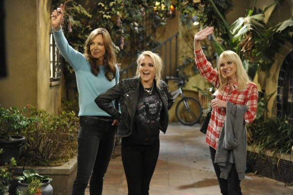 Allison Janney, Emily Osment, and Anna Faris wave to the live audience while filming a scene.
