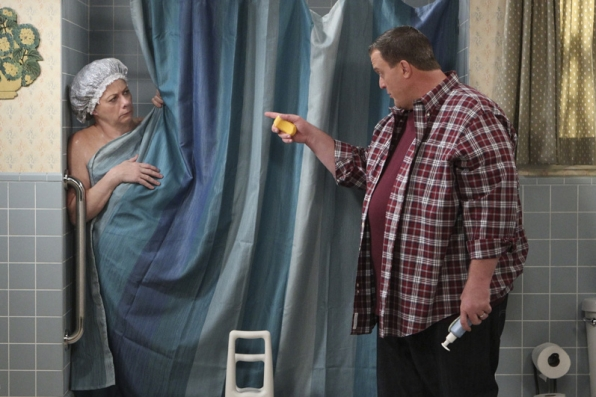 Peggy asks Mike for some assistance while she's showering.