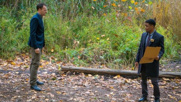 Jonny Lee Miller as Sherlock Holmes and Jon Michael Quinn as Detective Marcus Bell