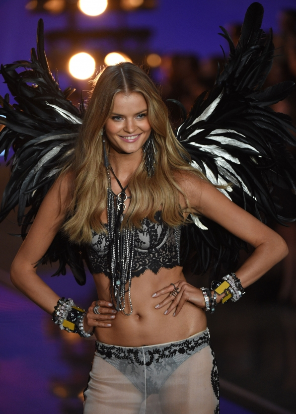 Kate Grigorieva glides down the VS runway in this pair of feathered black-and-white wings