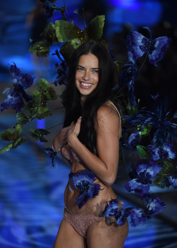 Adriana Lima floats down the runway while adorned in green and yellow butterflies