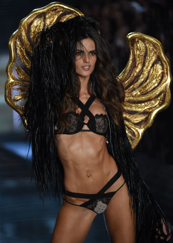 Izabel Goulart glistens in brilliant gold wings