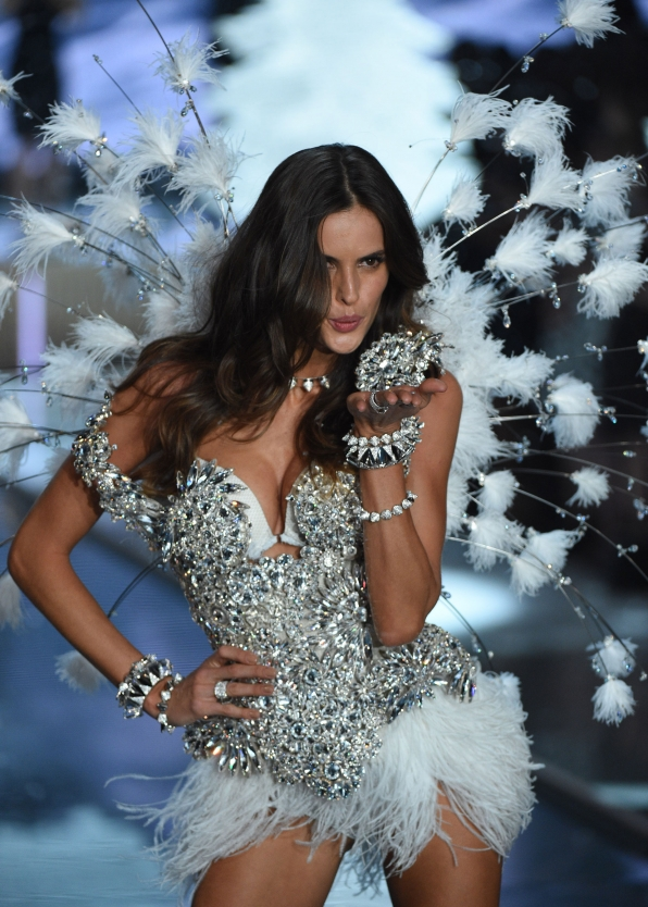 Izabel Goulart dazzles in a blinged-out one piece with dainty feather wings