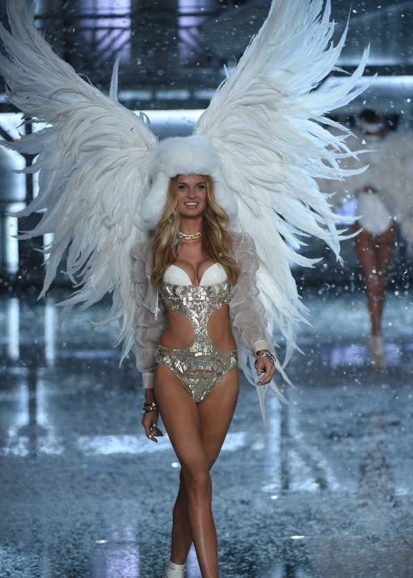 Romee Stijd wows in a intricately-beaded bodysuit and fluffy white trapper cap