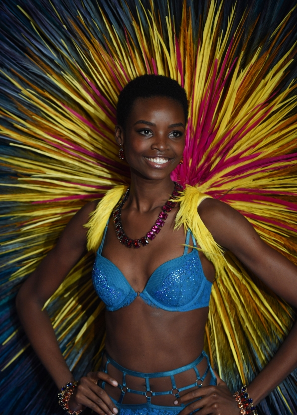 Maria Borges dons a burst of brilliant blue, yellow, and pink feathers