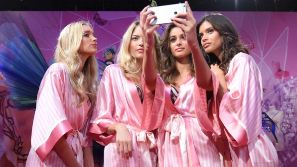 All wearing matching robes, Rachel Hilbert joins Angels Martha Hunt, Taylor Hill, and Sara Sampaio for a group shot
