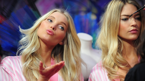 Elsa Hosk blows a kiss while Kate Grigorieva gets her brows brushed