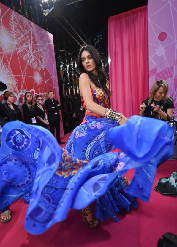 Kendall Jenner spins in silk before walking in the Boho Psychedelic segment
