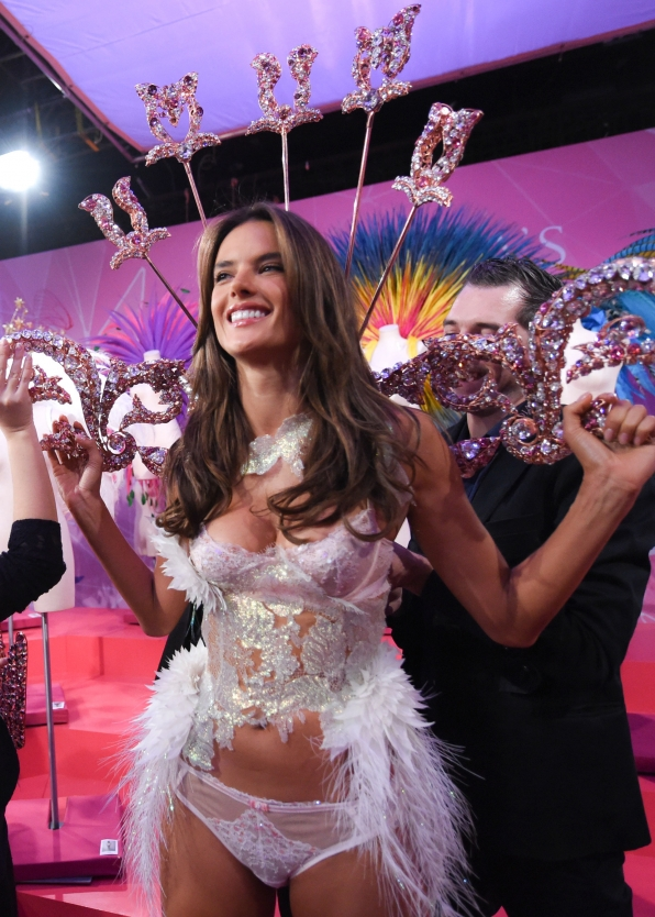 Angel Alessandra Ambrosio gets giddy in glitter before hitting the VS runway