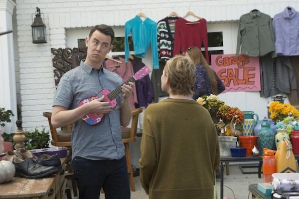 Greg shows off his mini-guitar skills to his mom, Joan.