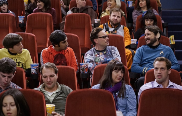 Howard, Raj, and Leonard sit at the movies with Wil Wheaton.