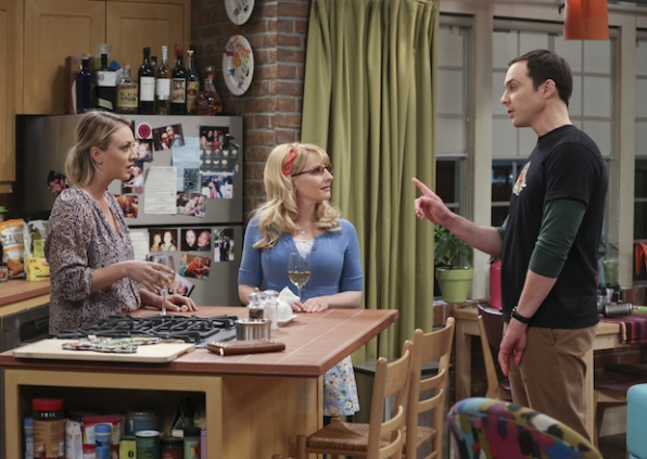 Sheldon chats with Penny and Bernadette.