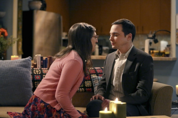 Amy moves closer to Sheldon.