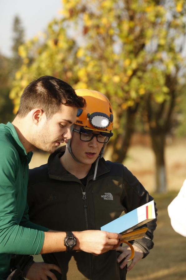 Tyler gets ready to search for artifacts in a cave with the support of his teammate, Korey.