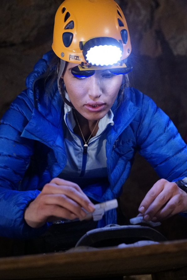 Jessica uses her headlamp to help piece the puzzle together.