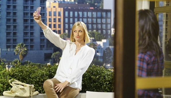Caroline takes a selfie from the hotel balcony.