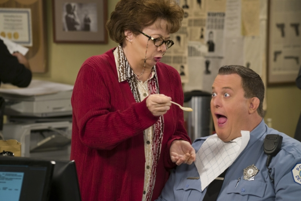 Peggy stops by the station and spoon-feeds Mike some applesauce.